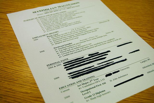 """Resume with """"personal faith"""" section crossed out in black marker"""