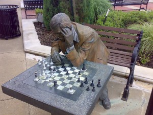 Statue of a man playing chess