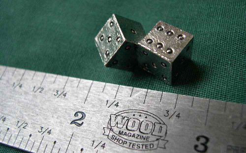 Ruler next to a pair of dice