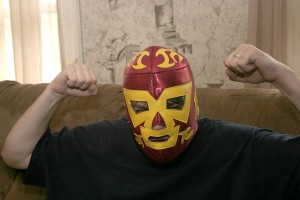 Man in a lucha libre mask, with clenched fists