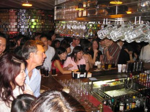 Many people crowding the bar