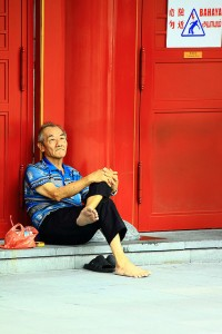 Old man sitting on the street