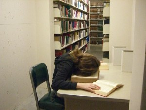Woman sleeping on top of the books