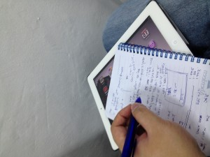 Notebook on top of an iPad