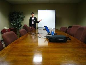 Man holding a presentation...alone