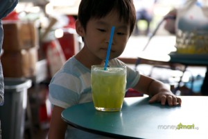 Kid staring at sugarcane juice