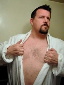 Man pulling his bathrobe open ala clark kent