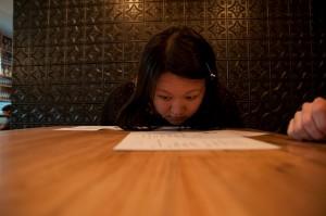 Staring closely at a menu