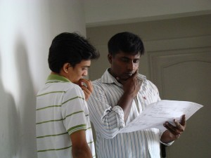 Two people looking at a plan, puzzled