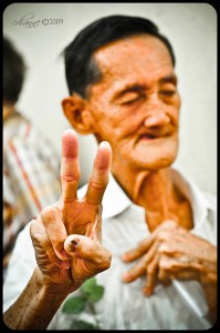 Old man giving V Sign