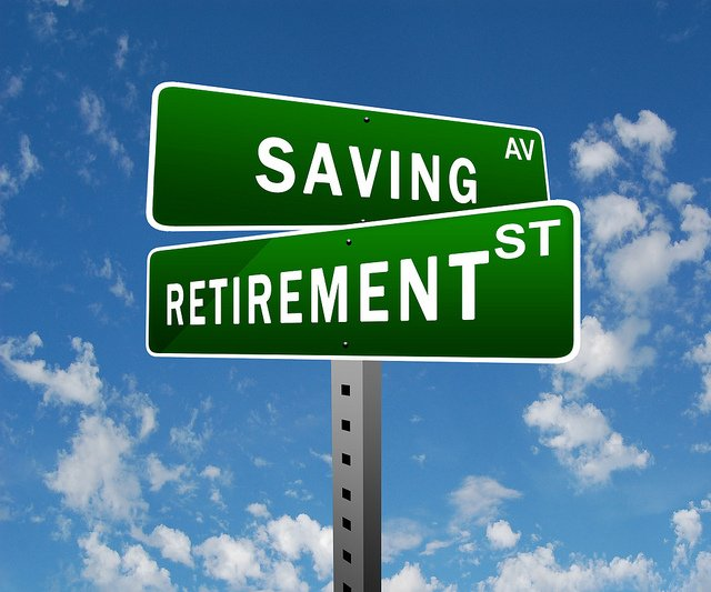 Road signs saying saving and retirement street