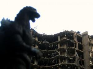 Godzilla smashing a house