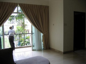 Owner looking out of condo
