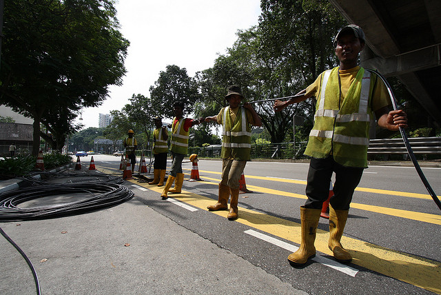 Workers laying fiber optic cable