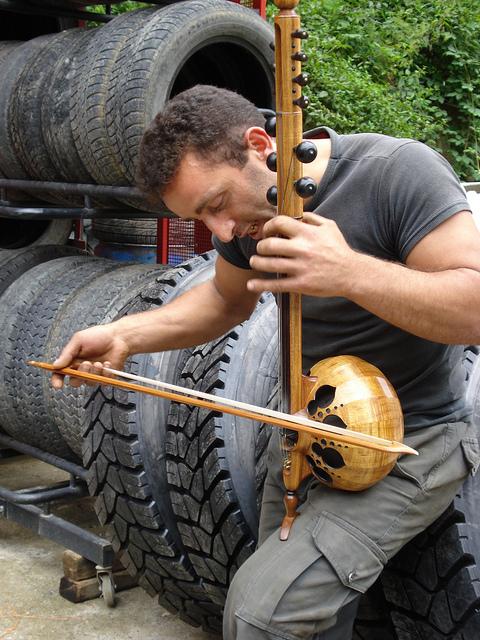 Mechanic playing musical instrument