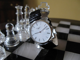 Wristwatch on chess board