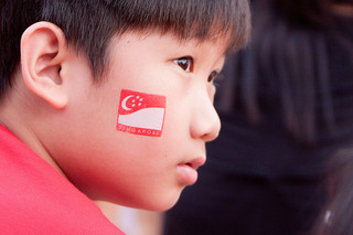 Kid with Singapore flag on his face
