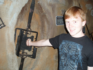 Kid with arm in an open bear trap