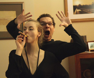 Man screaming behind woman with a cigar