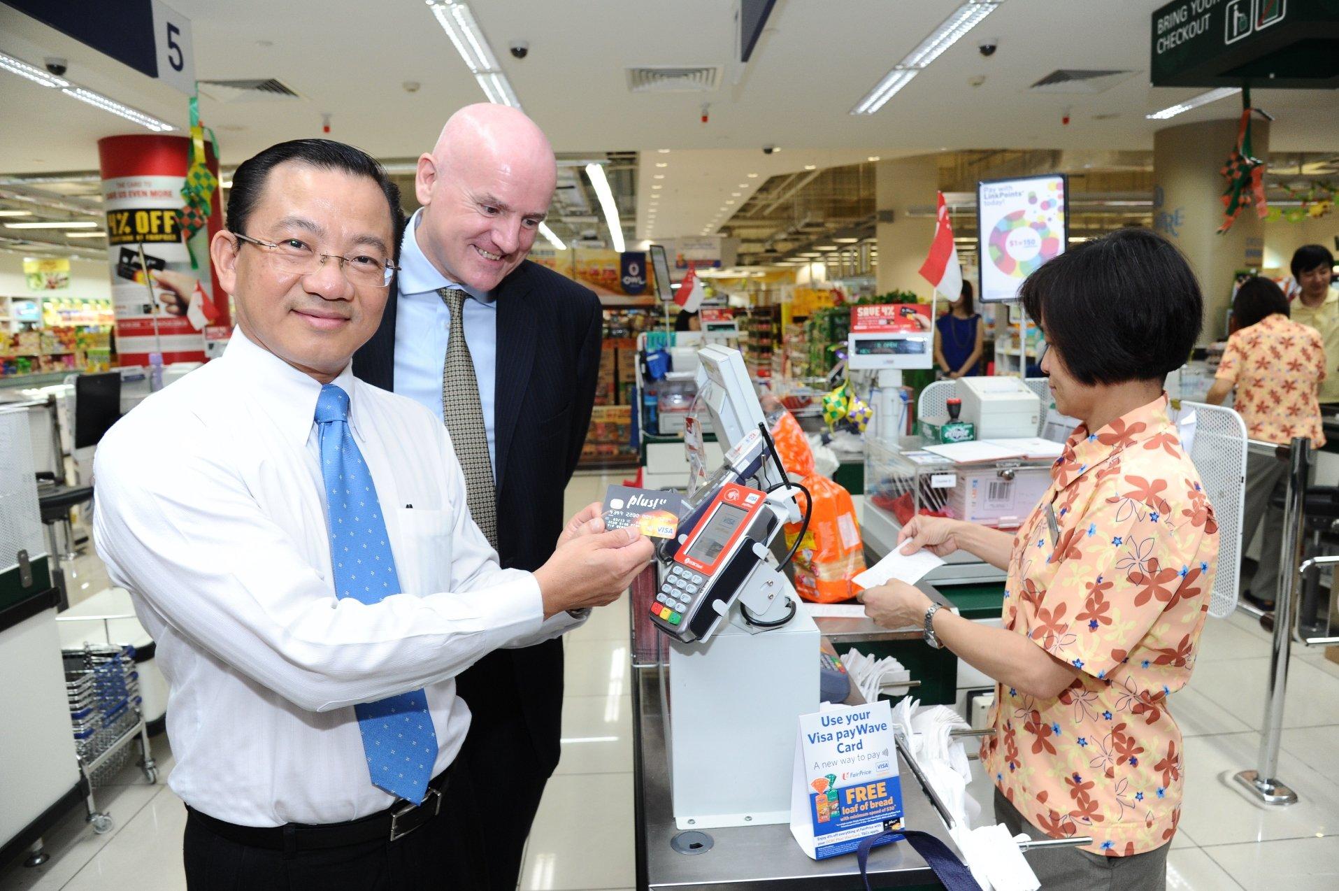 Seah Kian Peng making payment with Peter Maher watching