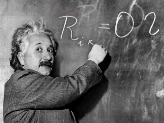 Einstein writing on blackboard