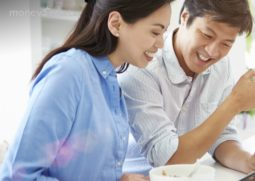 asian-couple-talking-tablet-header